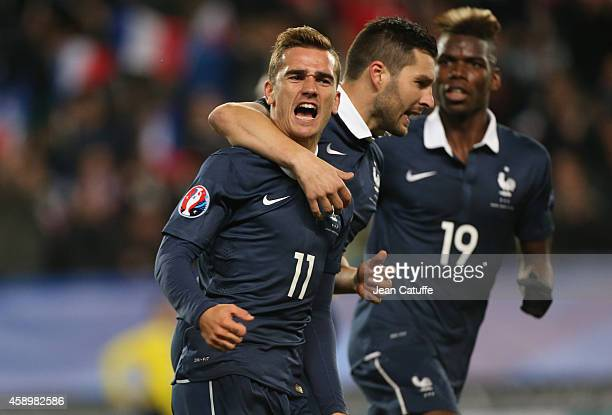 Antoine Griezmann of France celebrates his goal with AndrePierre Gignac and Paul Pogba during the international friendly match between France and...
