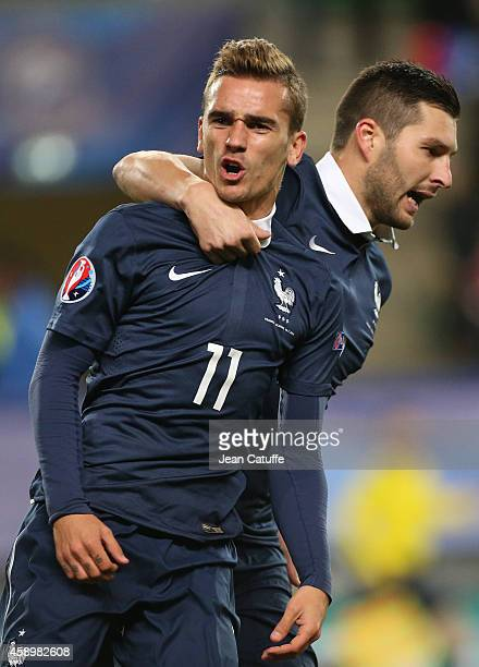 Antoine Griezmann of France celebrates his goal with AndrePierre Gignac during the international friendly match between France and Albania at Stade...