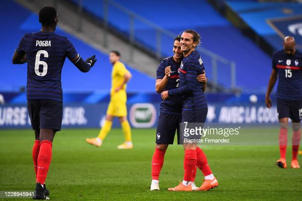Antoine GRIEZMANN of France celebrates his goal with Wissam BEN YEDDER of France and Paul POGBA of France during the international friendly match...