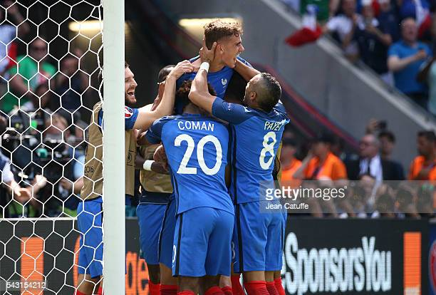 Antoine Griezmann of France celebrates his second goal with teammates during the UEFA EURO 2016 round of 16 match between France and Republic of...