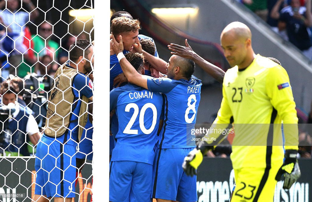 Antoine Griezmann of France celebrates his second goal with teammates while goalkeeper of Republic of Ireland Darren Randolph looks down during the UEFA EURO 2016 round of 16 match between France and Republic of Ireland at Stade des Lumieres, Parc OL on June 26, 2016 in Lyon, France.