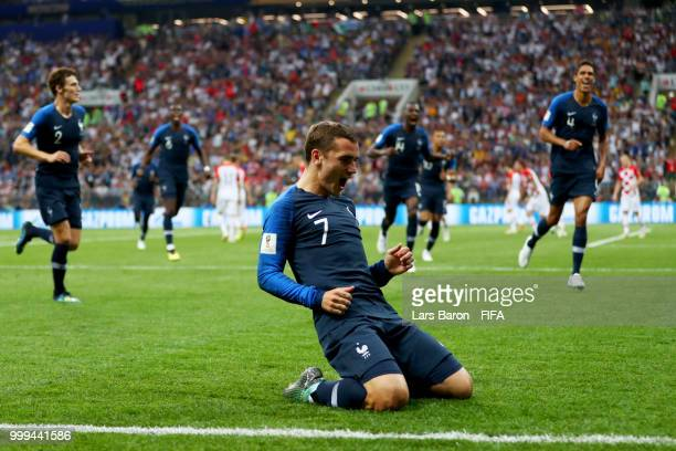 Antoine Griezmann of France celebrates his team's first goal an own goal by Mario Mandzukic of Croatia during the 2018 FIFA World Cup Final between...