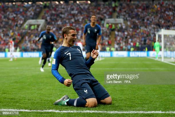 Antoine Griezmann of France celebrates his team's first goal, an own goal by Mario Mandzukic of Croatia during the 2018 FIFA World Cup Final between...