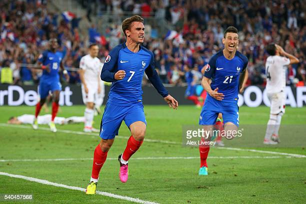 Antoine Griezmann of France celebrates scoring his sides first goal during the UEFA EURO 2016 Group A match between France and Albania at Stade...