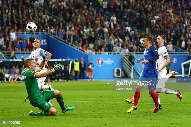 Antoine Griezmann of France celebrates scoring his team's fourth goal past Hannes Halldorsson of Iceland during the UEFA EURO 2016 quarter final...