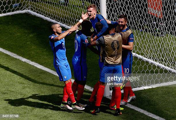 Antoine Griezmann of France celebrates scoring his team's second goal with his team mates during the UEFA EURO 2016 round of 16 match between France...