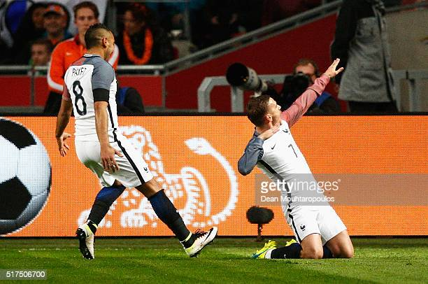 Antoine Griezmann of France celebrates scoring the opening goal with a free kick during the International Friendly match between Netherlands and...