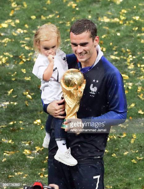 Antoine Griezmann of France celebrates victory with daughter Mia following the 2018 FIFA World Cup Russia Final between France and Croatia at...