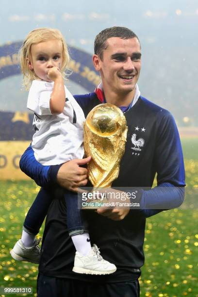 Antoine Griezmann of France celebrates with his daughter Mia Griezmann after the 2018 FIFA World Cup Russia Final between France and Croatia at...