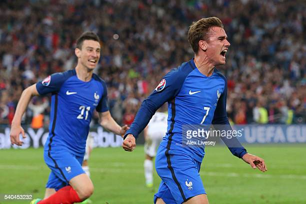 Antoine Griezmann of France celebrates with Laurent Koscielny scoring his sides first goal during the UEFA EURO 2016 Group A match between France and...