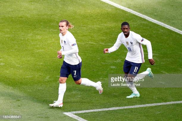 Antoine Griezmann of France celebrates with Ousmane Dembele after scoring their side's first goal during the UEFA Euro 2020 Championship Group F...
