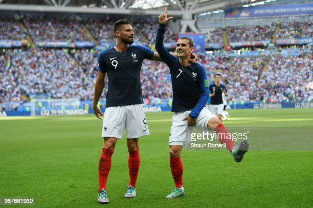 Antoine Griezmann of France celebrates with teammate Olivier Giroud after scoring his team's first goal during the 2018 FIFA World Cup Russia Round...