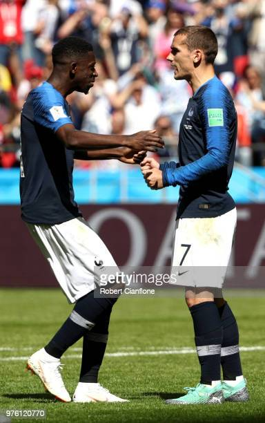 Antoine Griezmann of France celebrates with teammate Ousmane Dembele after scoring a penalty for his team's first goal during the 2018 FIFA World Cup...