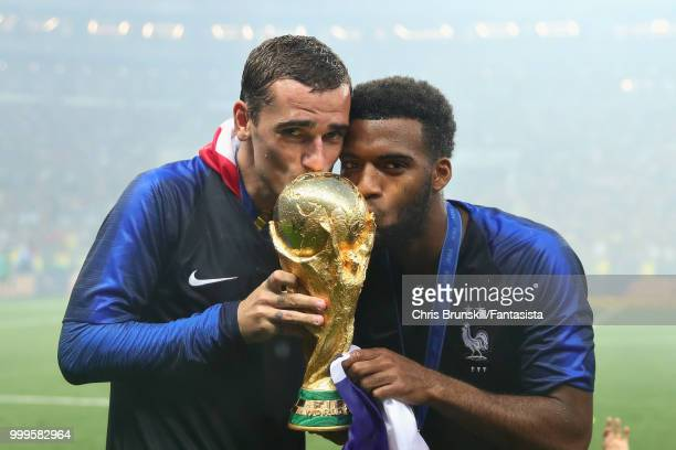 Antoine Griezmann of France celebrates with teammate Thomas Lemar after the 2018 FIFA World Cup Russia Final between France and Croatia at Luzhniki...