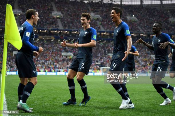 Antoine Griezmann of France celebrates with teammates after his free-kick leads to an own goal by Mario Mandzukic of Croatia, and France's first goal...
