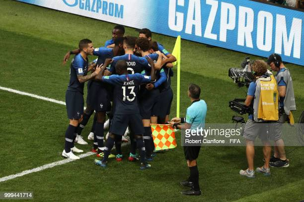 Antoine Griezmann of France celebrates with teammates after his freekick leads to an own goal by Mario Mandzukic of Croatia and France's first goal...