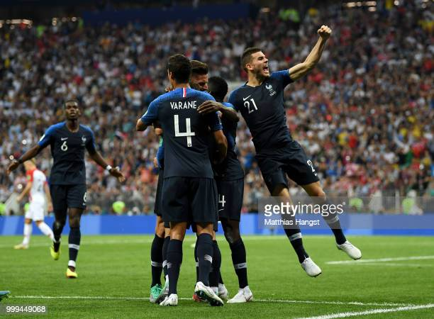 Antoine Griezmann of France celebrates with teammates after scoring a penalty for his team's second goal during the 2018 FIFA World Cup Final between...