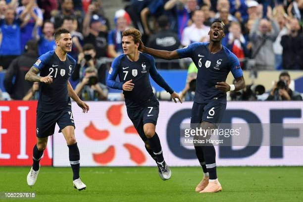 Antoine Griezmann of France celebrates with teammates after scoring his team's first goal during the UEFA Nations League A group one match between...