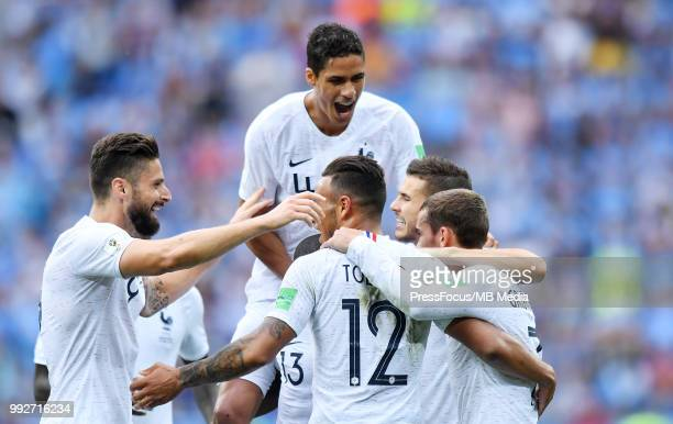 Antoine Griezmann of France celebrates with teammates Olivier Giroud Raphael Varane and Corentin Tolisso after scoring a goal during the 2018 FIFA...