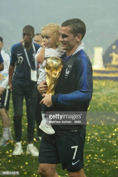 Antoine Griezmann of France celebrates with the FIFA World Cup trophy and his daughter during the 2018 FIFA World Cup Russia Final between France and...