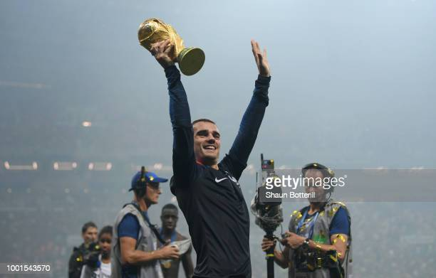 Antoine Griezmann of France celebrates with the trophy after the 2018 FIFA World Cup Russia Final between France and Croatia at Luzhniki Stadium on...
