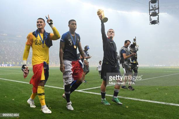 Antoine Griezmann of France celebrates with the World Cup Trophy following his sides victory in the 2018 FIFA World Cup Final between France and...
