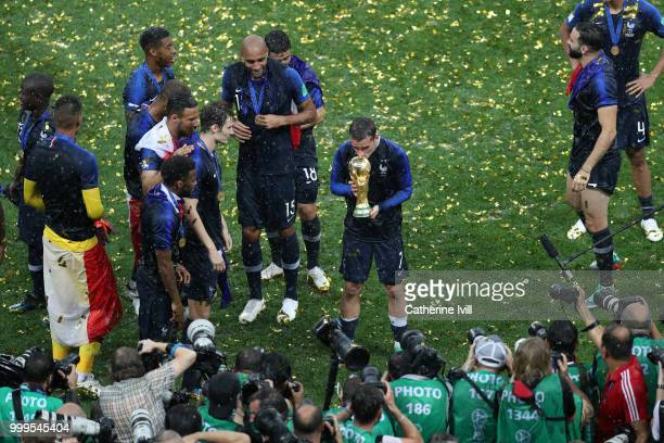 Antoine Griezmann of France celebrates with the World Cup trophy following the 2018 FIFA World Cup Final between France and Croatia at Luzhniki...