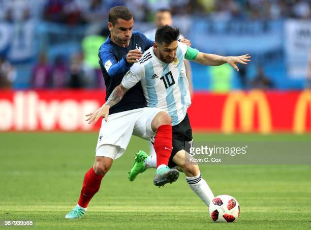 Antoine Griezmann of France challenges Lionel Messi of Argentina during the 2018 FIFA World Cup Russia Round of 16 match between France and Argentina...