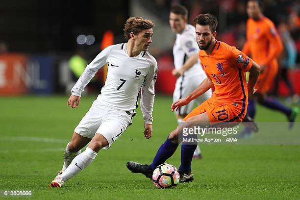 Antoine Griezmann of France competes with Davy Propper of the Netherlands during the FIFA 2018 World Cup Qualifier between The Netherlands and France...