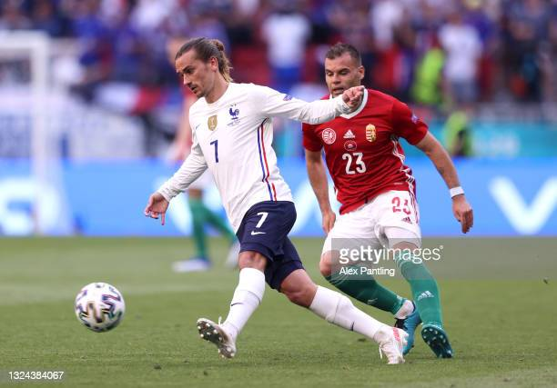 Antoine Griezmann of France controls the ball whilst under pressure from Nemanja Nikolic of Hungary during the UEFA Euro 2020 Championship Group F...