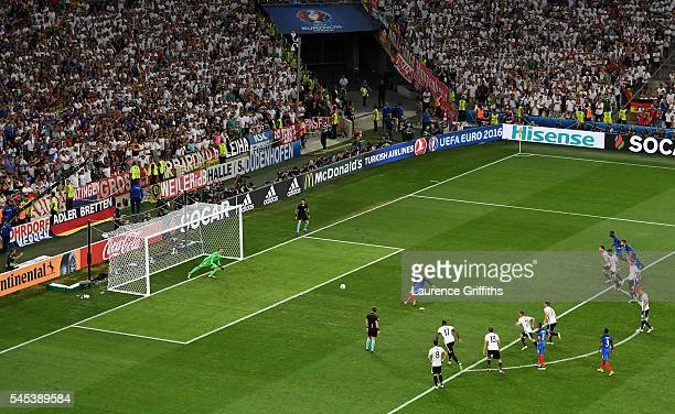 Antoine Griezmann of France converts the penalty to score the opening goal during the UEFA EURO semi final match between Germany and France at Stade...