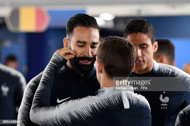 Antoine Griezmann of France fixes Adil Rami of France's moustache in the tunnel before the warm up prior to the 2018 FIFA World Cup Russia Semi Final...