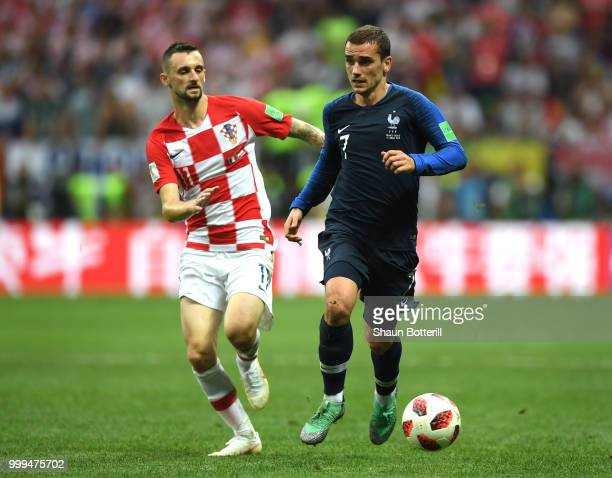 Antoine Griezmann of France goes past Marcelo Brozovic of Croatia during the 2018 FIFA World Cup Final between France and Croatia at Luzhniki Stadium...