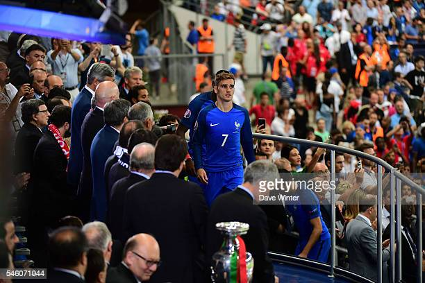 Antoine Griezmann of France goes up to collect his loser's medal following the European Championship Final between Portugal and France at Stade de...