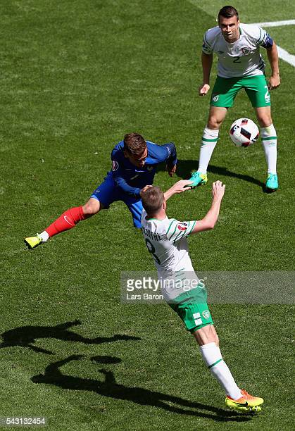 Antoine Griezmann of France heads the ball to score his team's first goal during the UEFA EURO 2016 round of 16 match between France and Republic of...