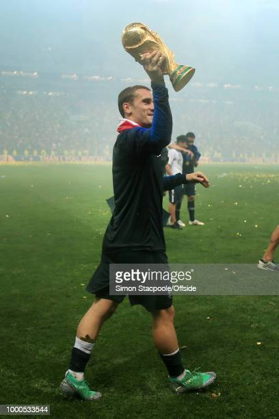 Antoine Griezmann of France holds the trophy aloft after the 2018 FIFA World Cup Russia Final between France and Croatia at the Luzhniki Stadium on...