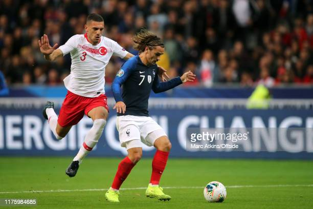 Antoine Griezmann of France in action with Merih Demiral of Turkey during the UEFA Euro 2020 qualifier between France and Turkey on October 14 2019...