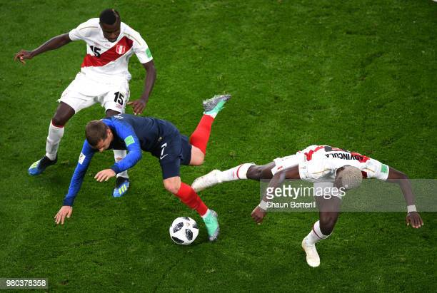 Antoine Griezmann of France is challenged by Christian Ramos of Peru and Luis Advincula of Peru during the 2018 FIFA World Cup Russia group C match...