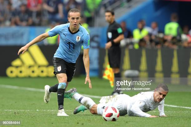 Antoine Griezmann of France is challenged by Diego Laxalt of Uruguay during the 2018 FIFA World Cup Russia Quarter Final match between Uruguay and...