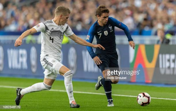 Antoine Griezmann of France is challenged by Matthias Ginter of Germany during the UEFA Nations League A group one match between France and Germany...