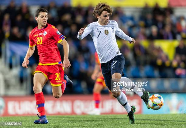 Antoine Griezmann of France is challenged by Max Llovera of Andorra during the UEFA Euro 2020 Qualifier Group H match between Andorra and France at...