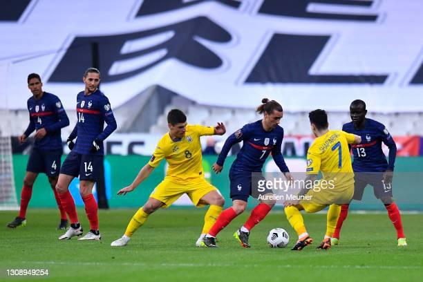 Antoine Griezmann of France is closed down by Ruslan Malinovskiy and Mykola Shaparenko of Ukraine during the FIFA World Cup 2022 Qatar qualifying...