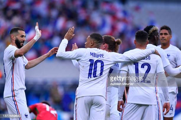 Antoine Griezmann of France is congratulated by Kylian Mbappe and Karim Benzama after scoring during the international friendly match between France...