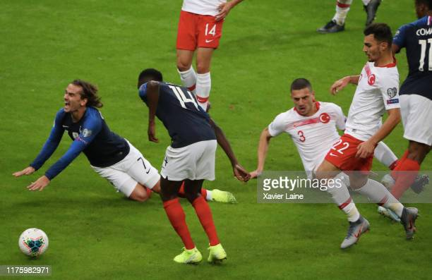 Antoine Griezmann of France is slash by Merih Demiral of Turkey during the 2020 UEFA European Championships Group H qualifying match between France...