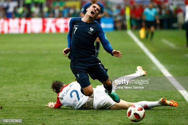 Antoine Griezmann of France is stopped by Sime Vrsaljko of Croatia during the 2018 FIFA World Cup Russia final match between France and Croatia at...