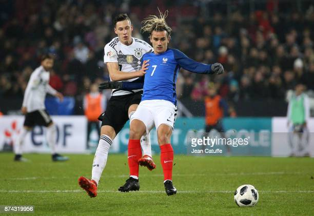 Antoine Griezmann of France Julian Draxler of Germany during the international friendly match between Germany and France at RheinEnergieStadion on...