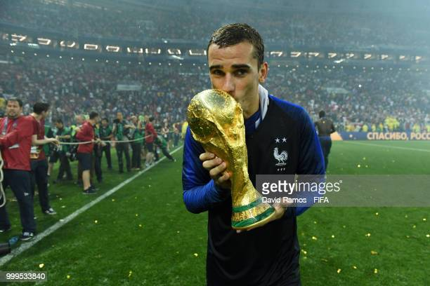Antoine Griezmann of France kisses the World Cup trophy in celebration following the 2018 FIFA World Cup Final between France and Croatia at Luzhniki...