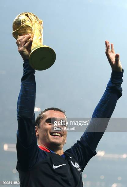 Antoine Griezmann of France lifts the World Cup trophy following the 2018 FIFA World Cup Final between France and Croatia at Luzhniki Stadium on July...
