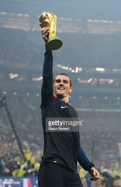 Antoine Griezmann of France lifts the World Cup trophy in celebration following the 2018 FIFA World Cup Final between France and Croatia at Luzhniki...
