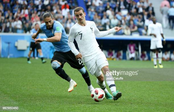 Antoine Griezmann of France Martin Caceres of Uruguay during the 2018 FIFA World Cup Russia Quarter Final match between Uruguay and France at Nizhny...